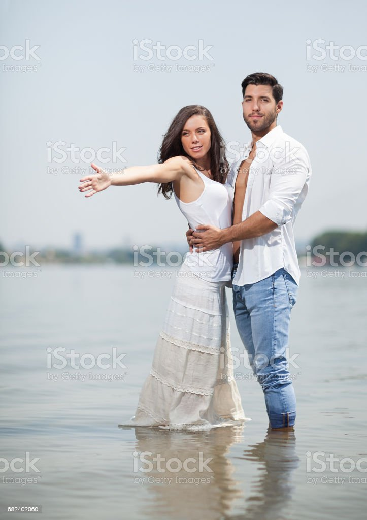 happy couple in love on beach,selective focus. royalty-free stock photo