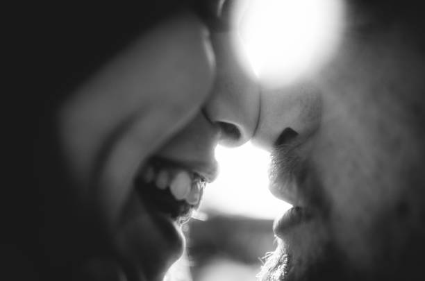 Happy couple in love touching noses. Close-up nose to nose stock photo