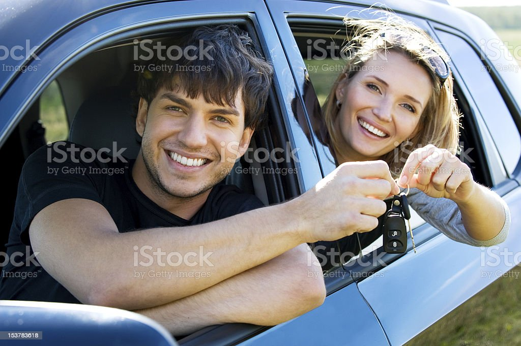 Happy couple in new car royalty-free stock photo