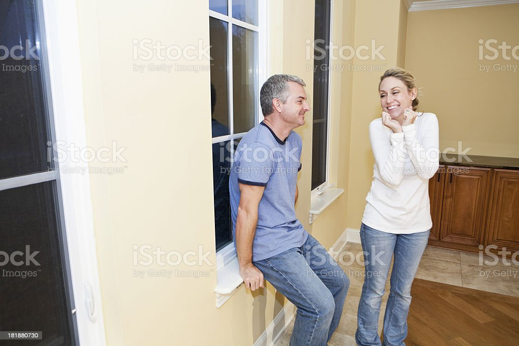 Happy couple in new home stock photo