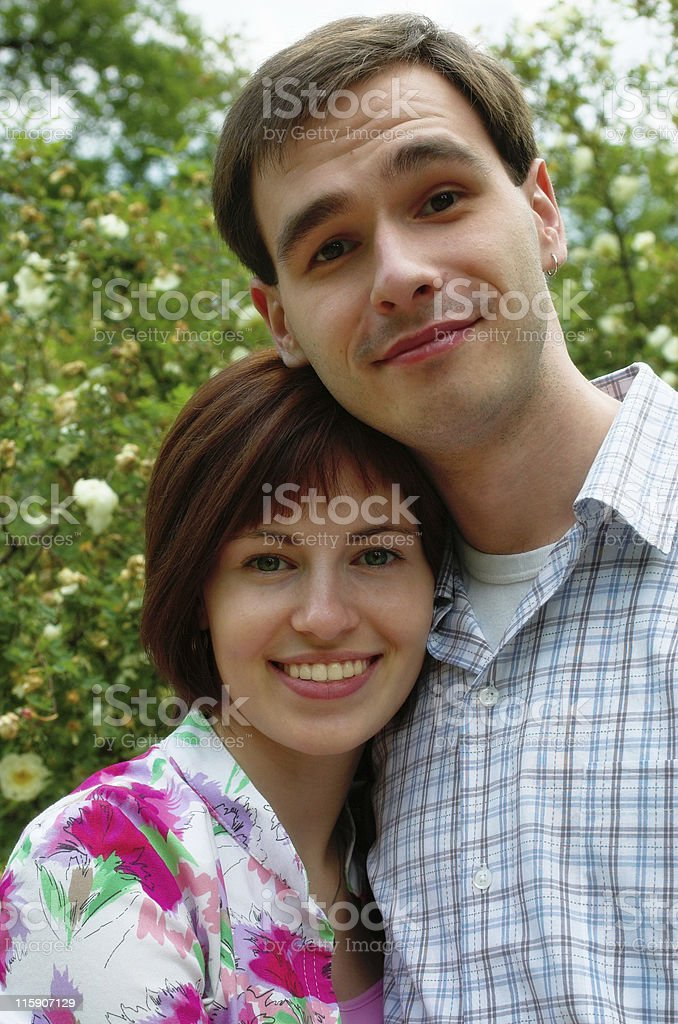 Happy couple in the flower garden royalty-free stock photo