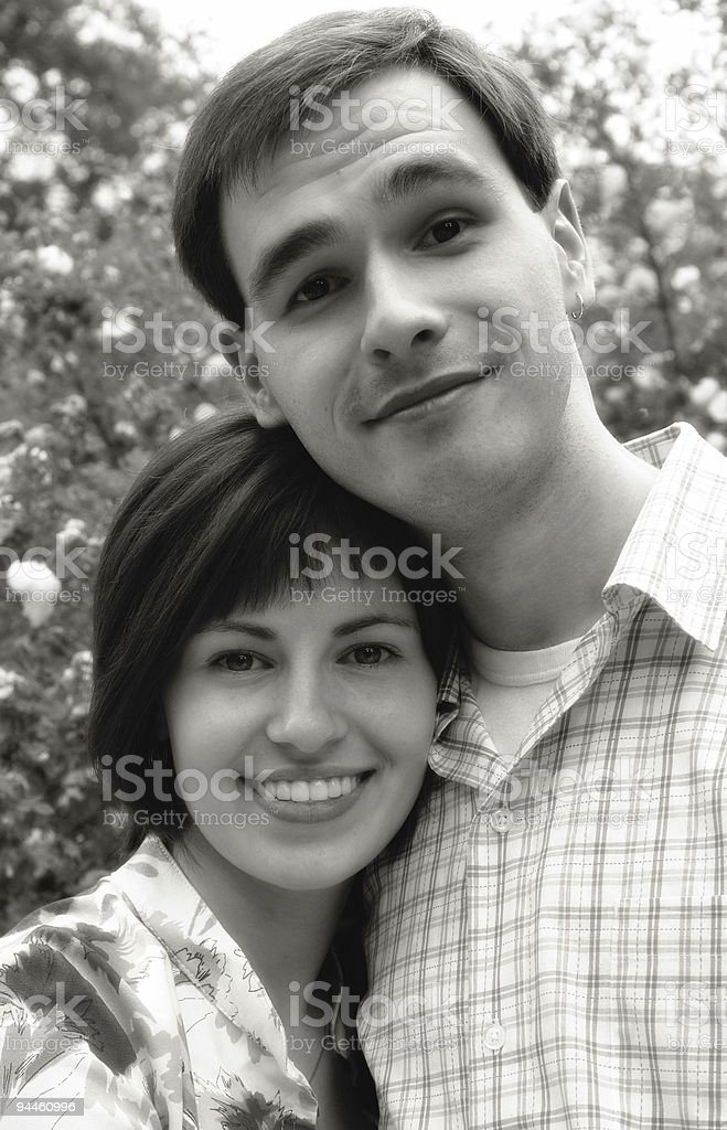 Happy couple in the flower royalty-free stock photo