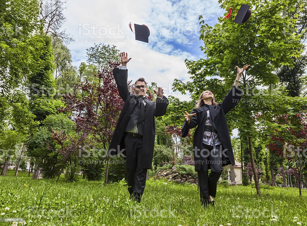 Happy Couple in the Graduation Day stock photo