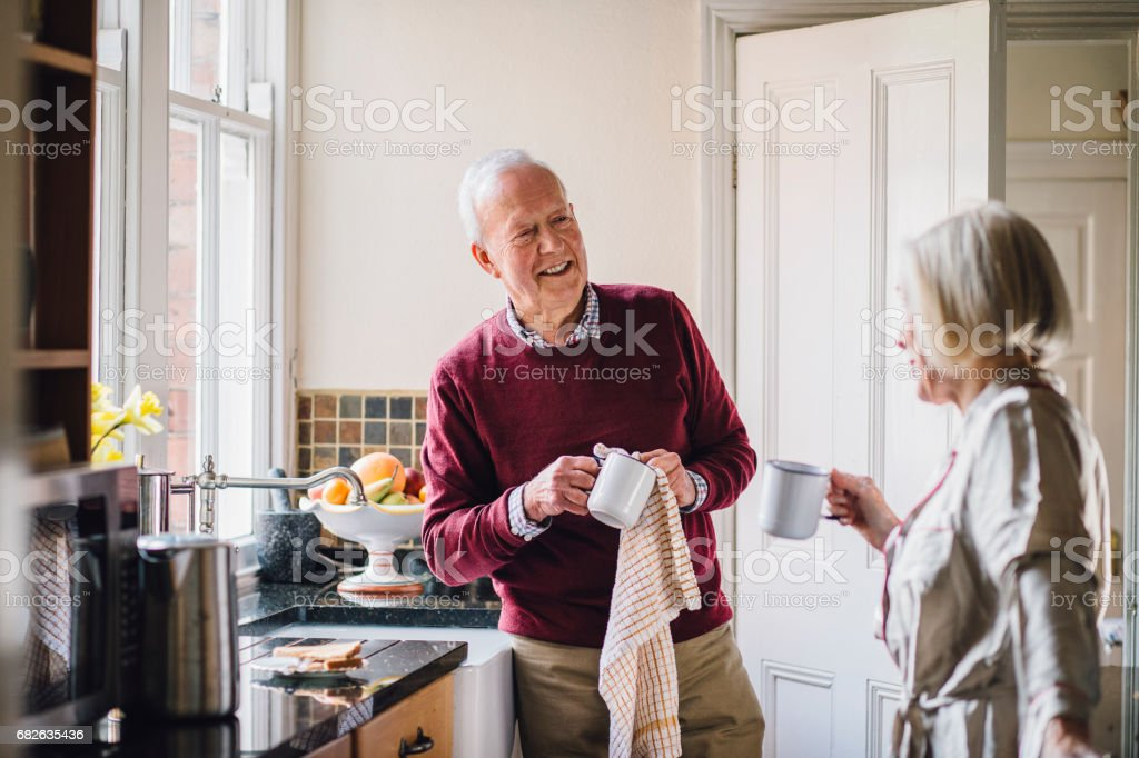 Happy Couple In The Kitchen stock photo