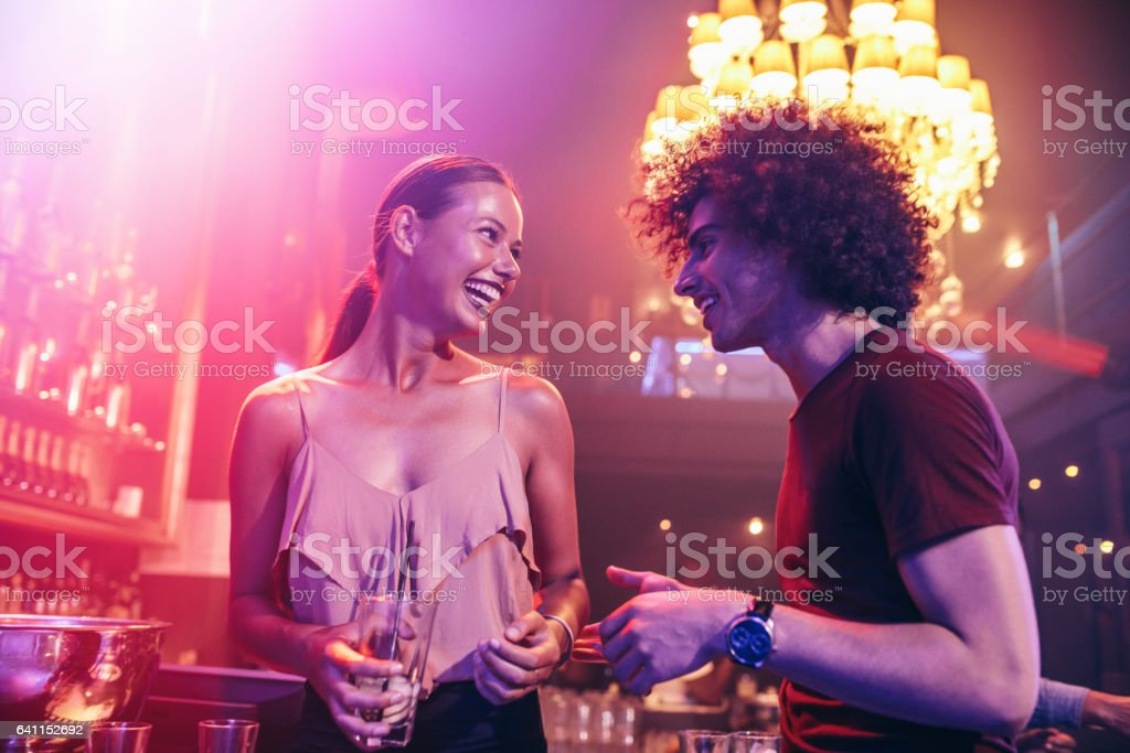 Happy couple in the night club stock photo