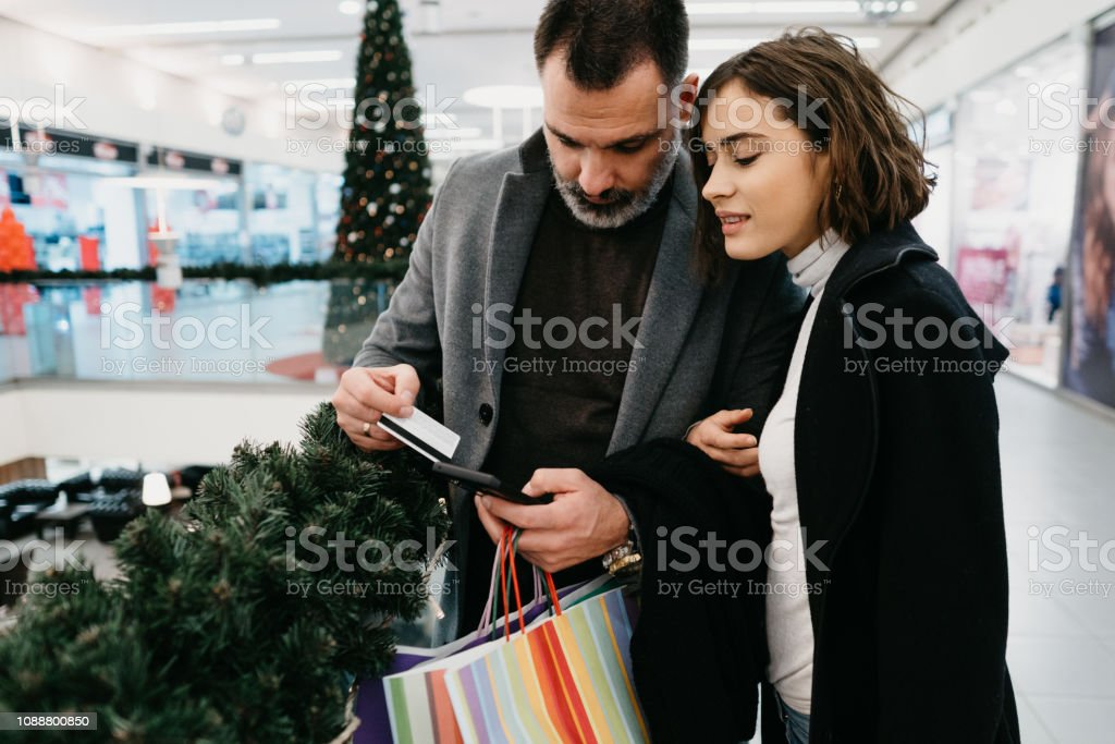 Happy couple in the shopping center stock photo