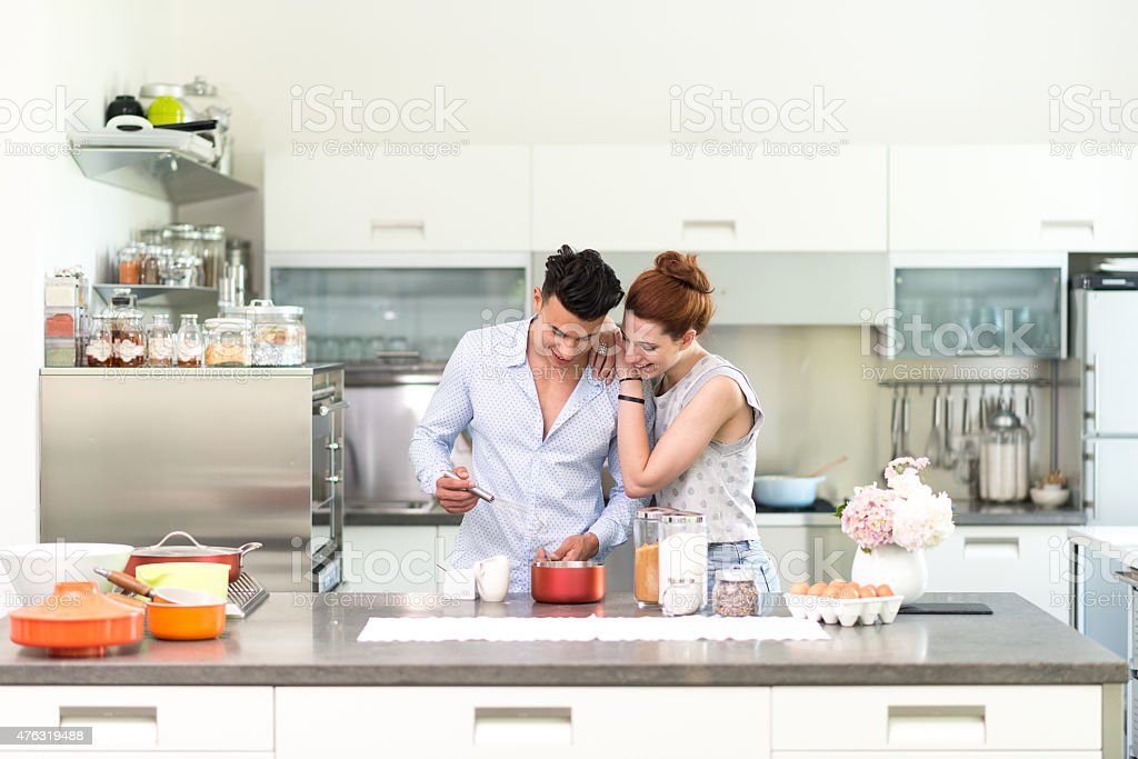 Happy couple in their new kitchen stock photo