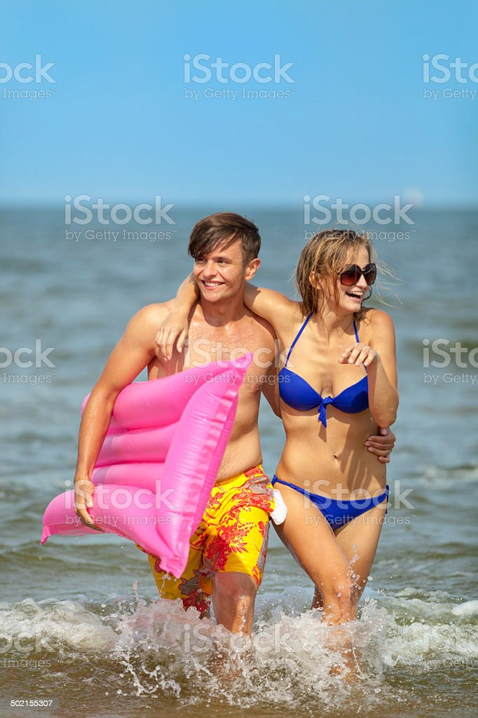 Happy Couple In Water royalty-free stock photo