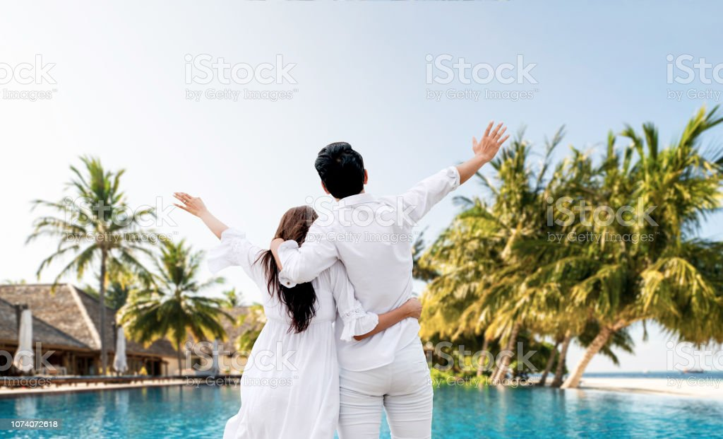 Happy couple is on vacation and escape to nature. stock photo