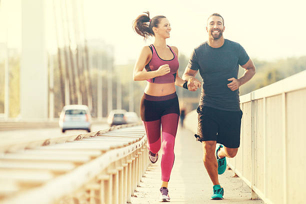 happy couple jogging - jogging stock pictures, royalty-free photos & images