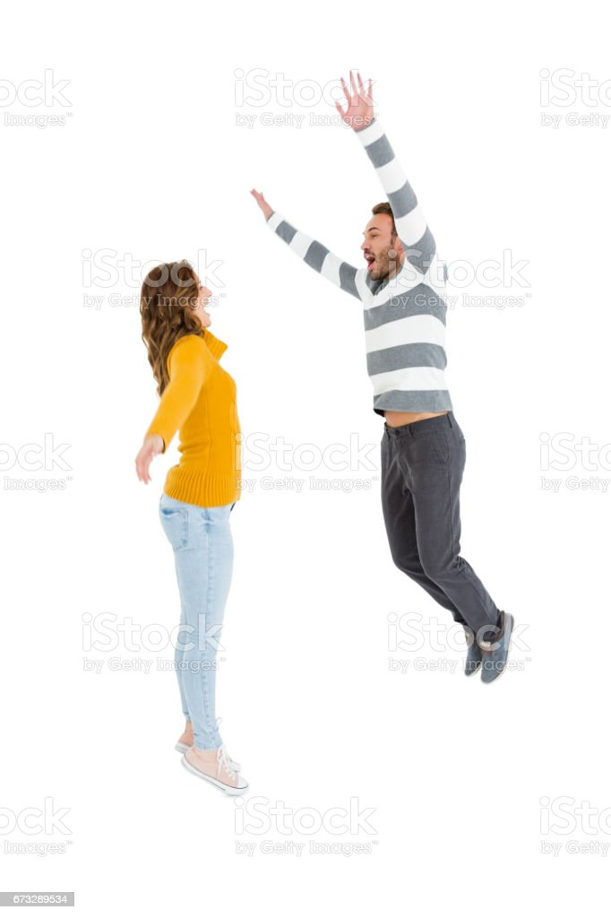 Happy couple jumping in excited royalty-free stock photo