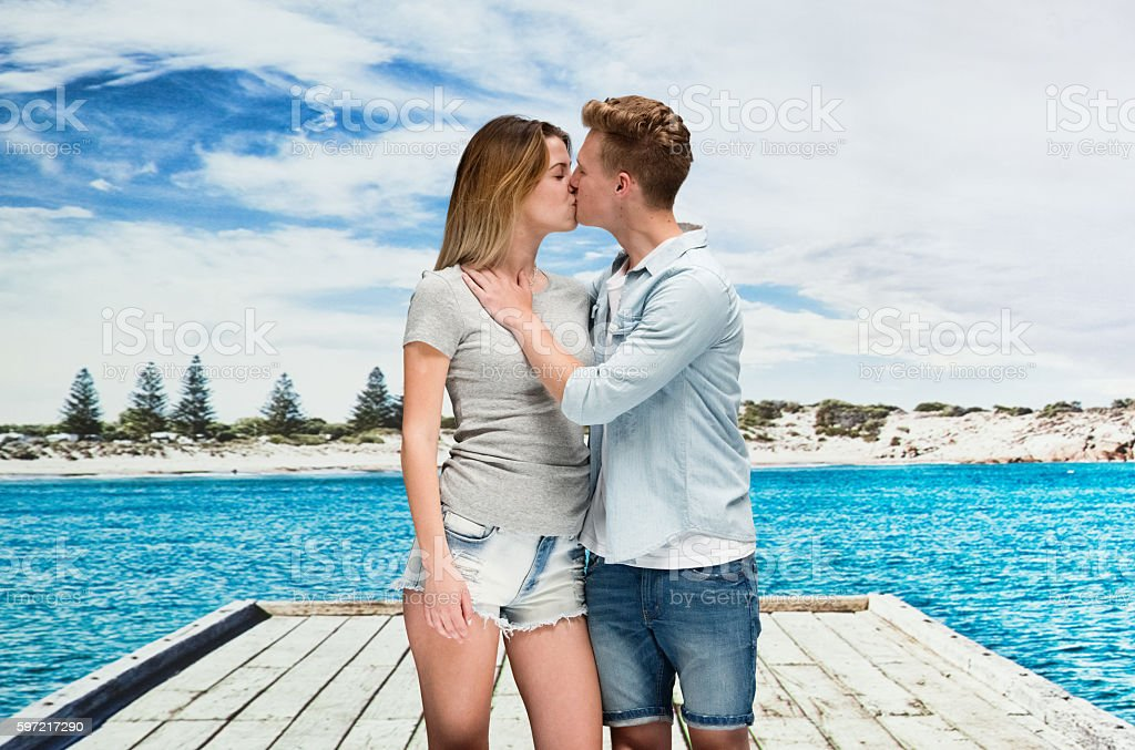 Happy couple kissing outdoors stock photo