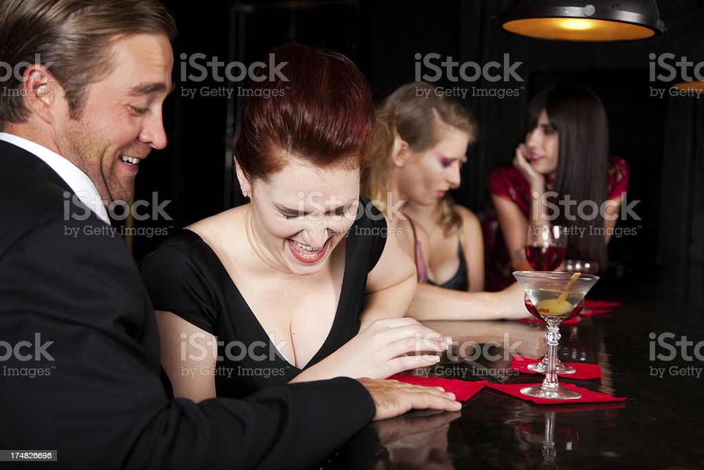 Happy Couple Laughing in Bar stock photo