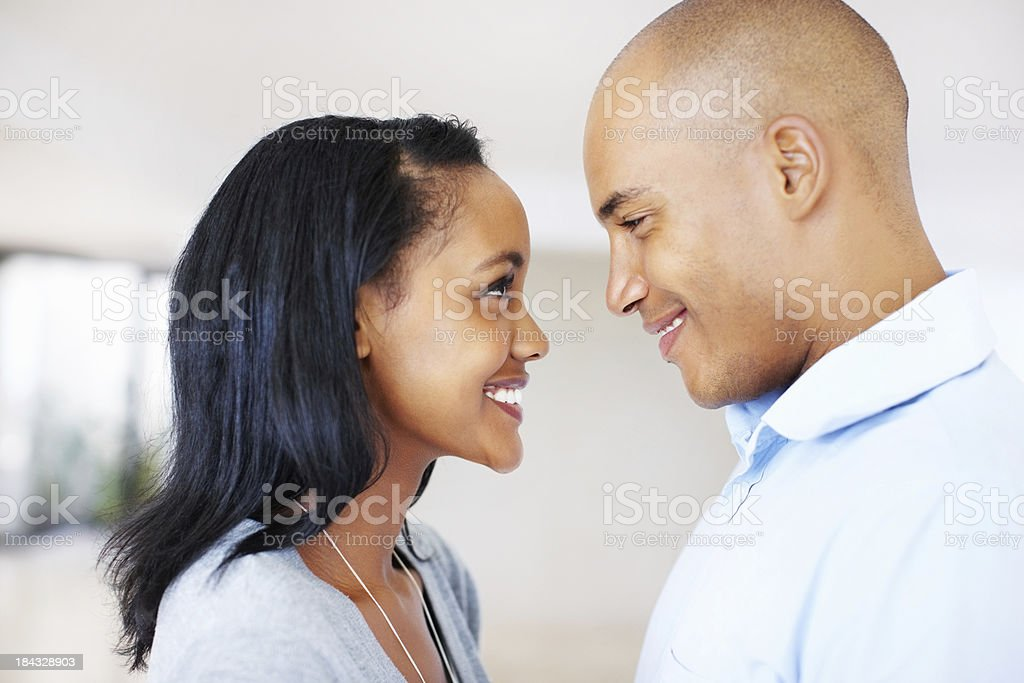 Happy couple looking at each other stock photo