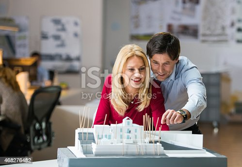 istock Happy Couple looking at Their Future House 468276482
