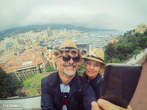 Smiling couple taking a selfie with mobile phone.