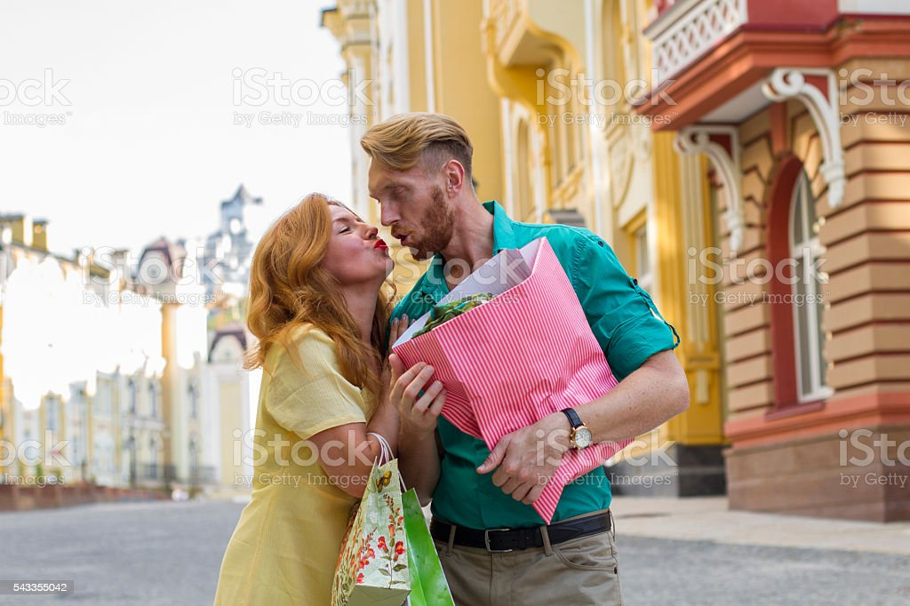 happy couple man and woman with shopping bags stock photo