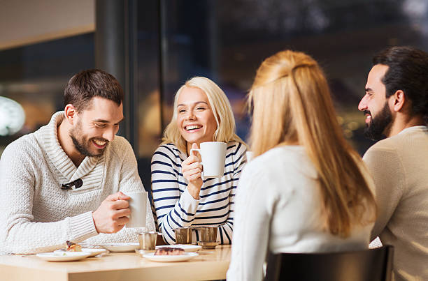 happy couple meeting and drinking tea or coffee - family meeting stock photos and pictures