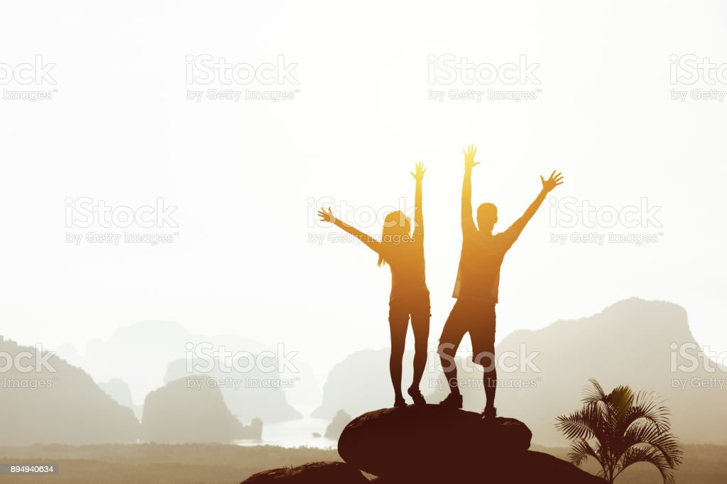 Happy couple mountains and islands travel concept stock photo
