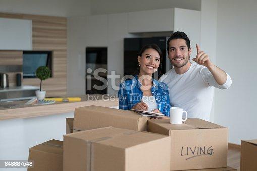 1174436608 istock photo Happy couple moving house 646687548
