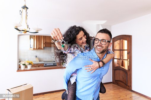 istock Happy couple moving in new home 905898270