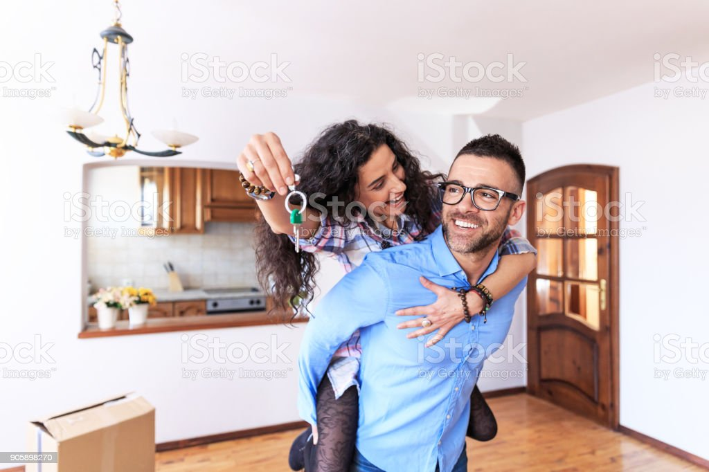 Happy couple moving in new home stock photo