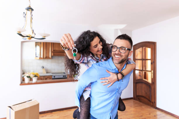happy couple moving in new home - house hunting stock photos and pictures