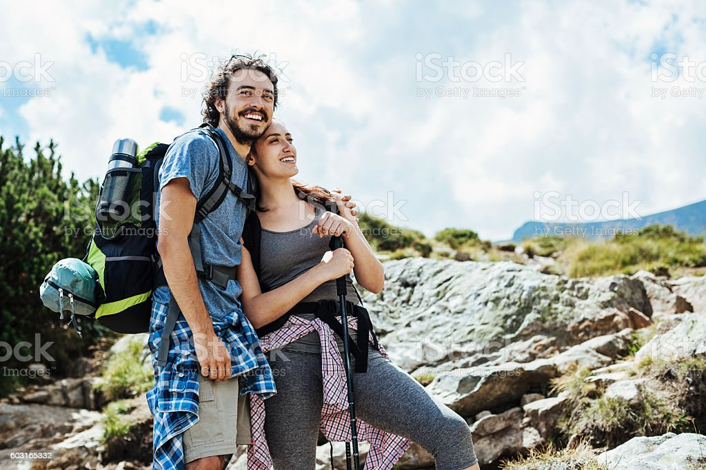 Happy couple of hikers stock photo