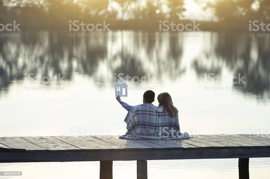 Happy couple of kids dream of a home stock photo
