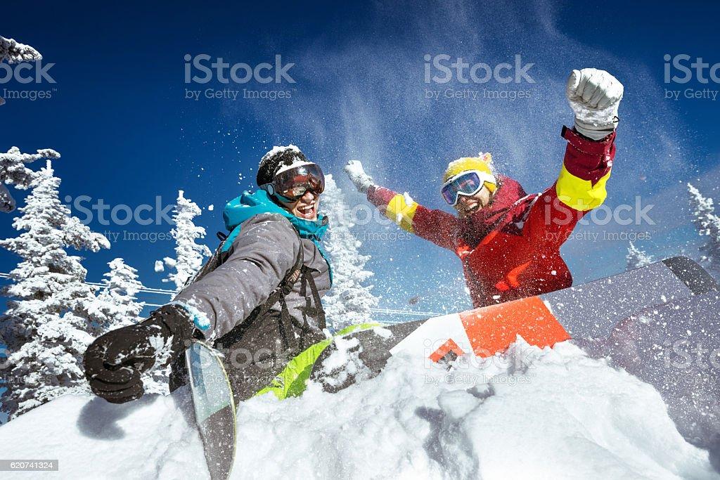 Happy couple of snowboarders having fun - foto de stock