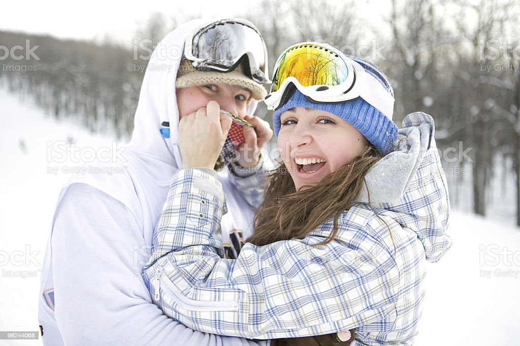 Happy couple of snowboarders royalty-free stock photo