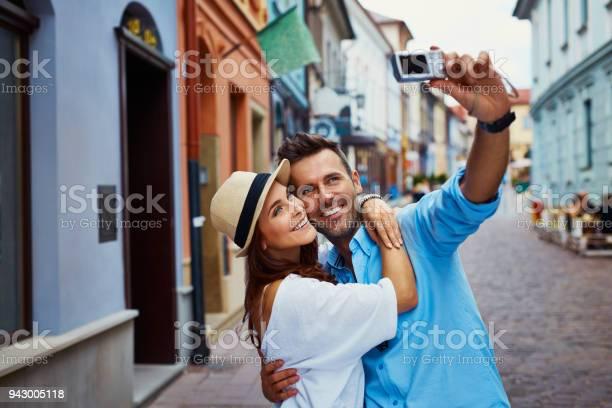 Happy couple of tourists taking selfie in old city picture id943005118?b=1&k=6&m=943005118&s=612x612&h=eqay 5nuuqtolkainwojt1mrgqbejw ltgzl0qvla8i=