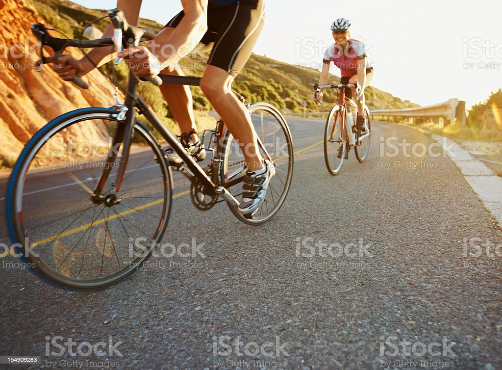 Happy couple on a bike ride royalty-free stock photo