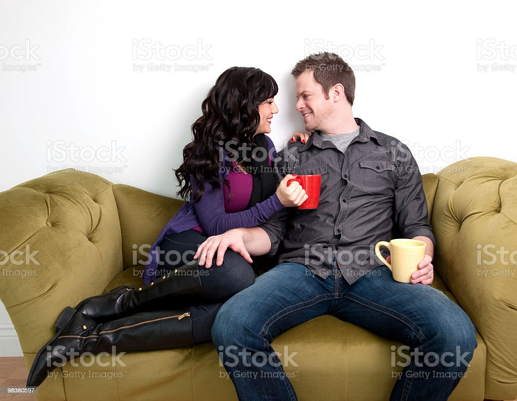 happy couple on a sofa royalty-free stock photo