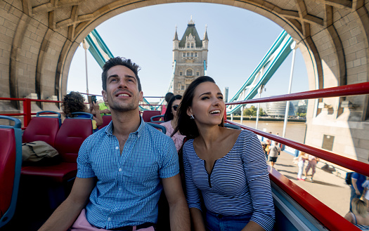 Happy couple on a tour bus
