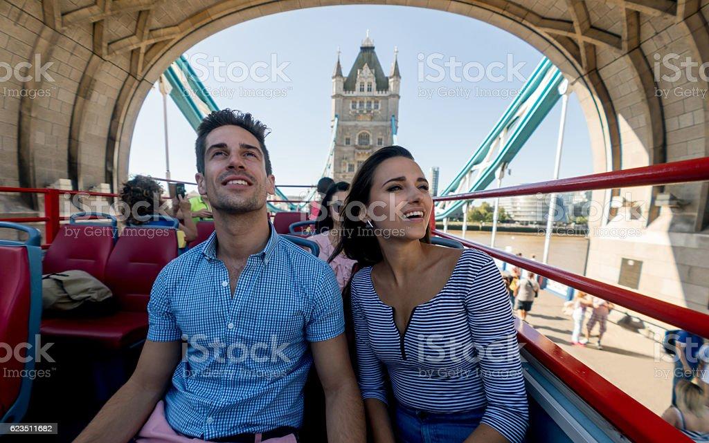 Happy couple on a tour bus stock photo