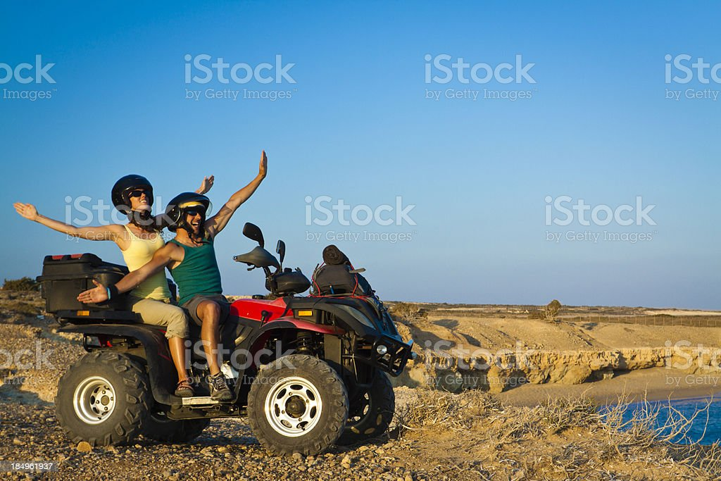 happy couple on atv royalty-free stock photo