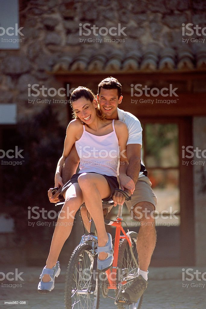 Happy couple on bicycle royalty-free stock photo