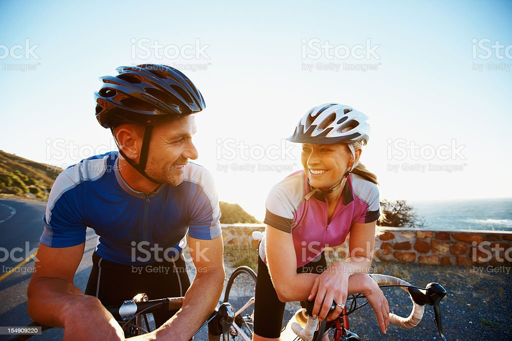 Happy couple on bicycles royalty-free stock photo