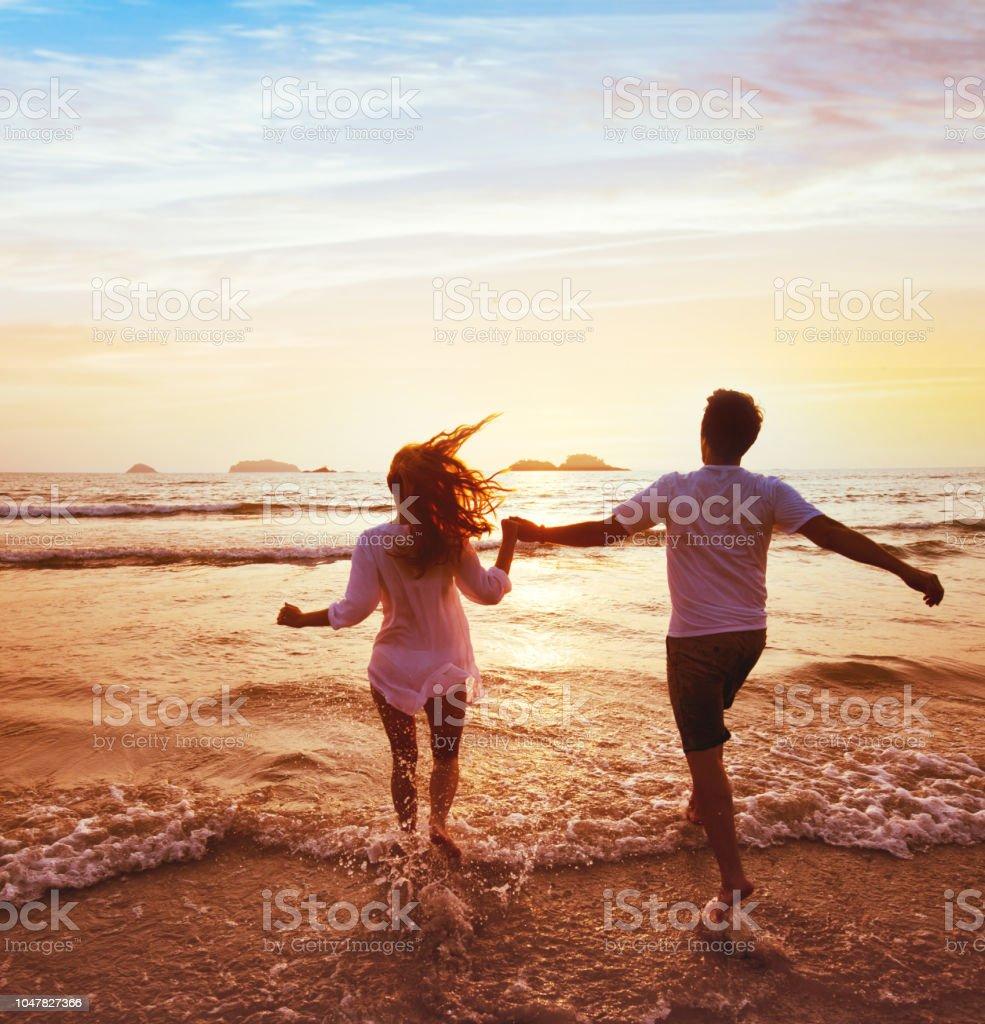 happy couple on honeymoon vacation travel, beach holidays stock photo