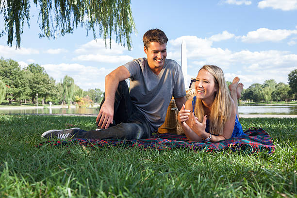 happy couple on picnic - carolinemaryan stock pictures, royalty-free photos & images