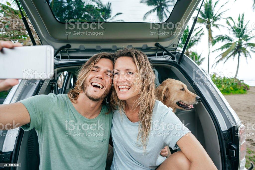 Happy couple on road trip stock photo