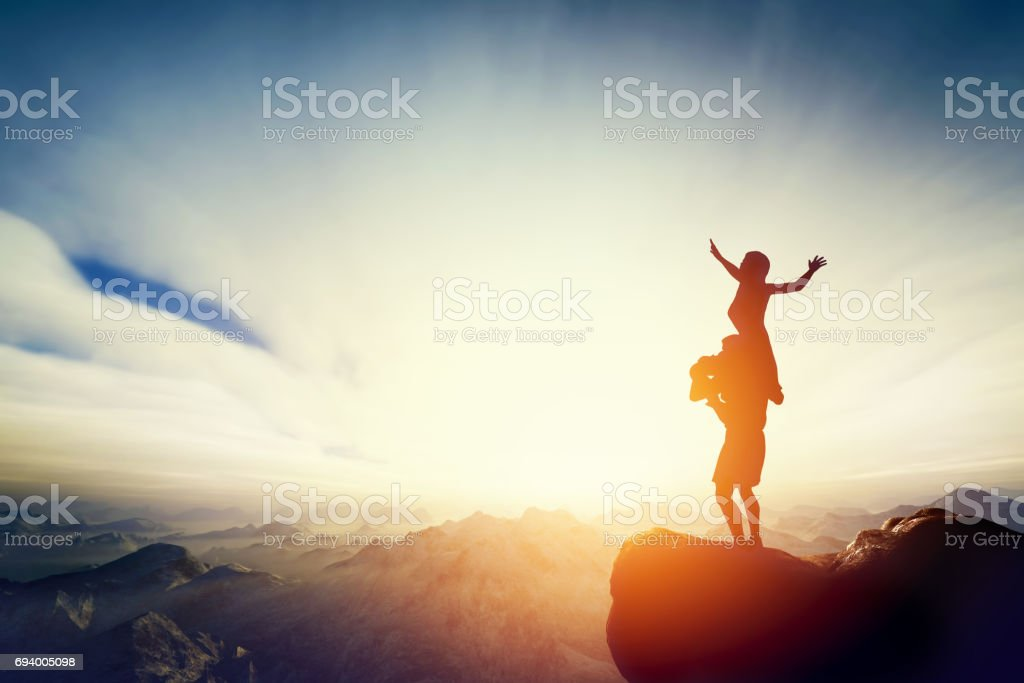 Happy couple on the top of the world! Man holding woman on his arms stock photo
