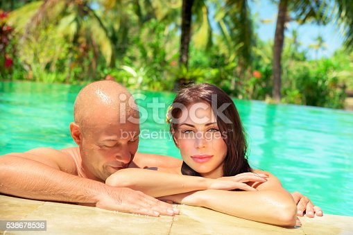 1055009962 istock photo Happy couple on tropical resort 538678536