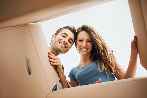 istock Happy couple opening a box 499264816