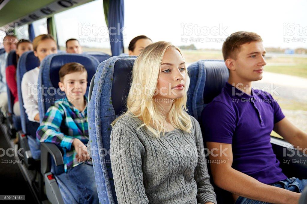 happy couple or passengers in travel bus stock photo