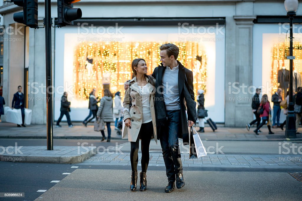Happy couple out shopping stock photo