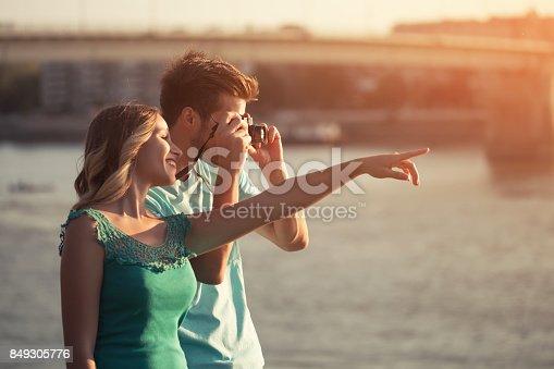 636330566istockphoto Happy couple photographing 849305776