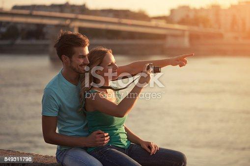 636330566istockphoto Happy couple photographing 849311798