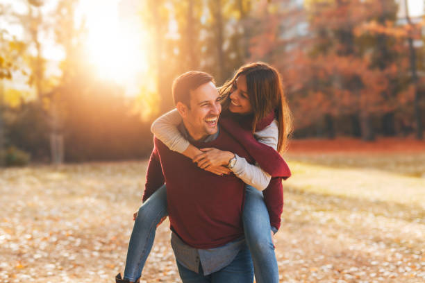 happy couple - autumn stock pictures, royalty-free photos & images